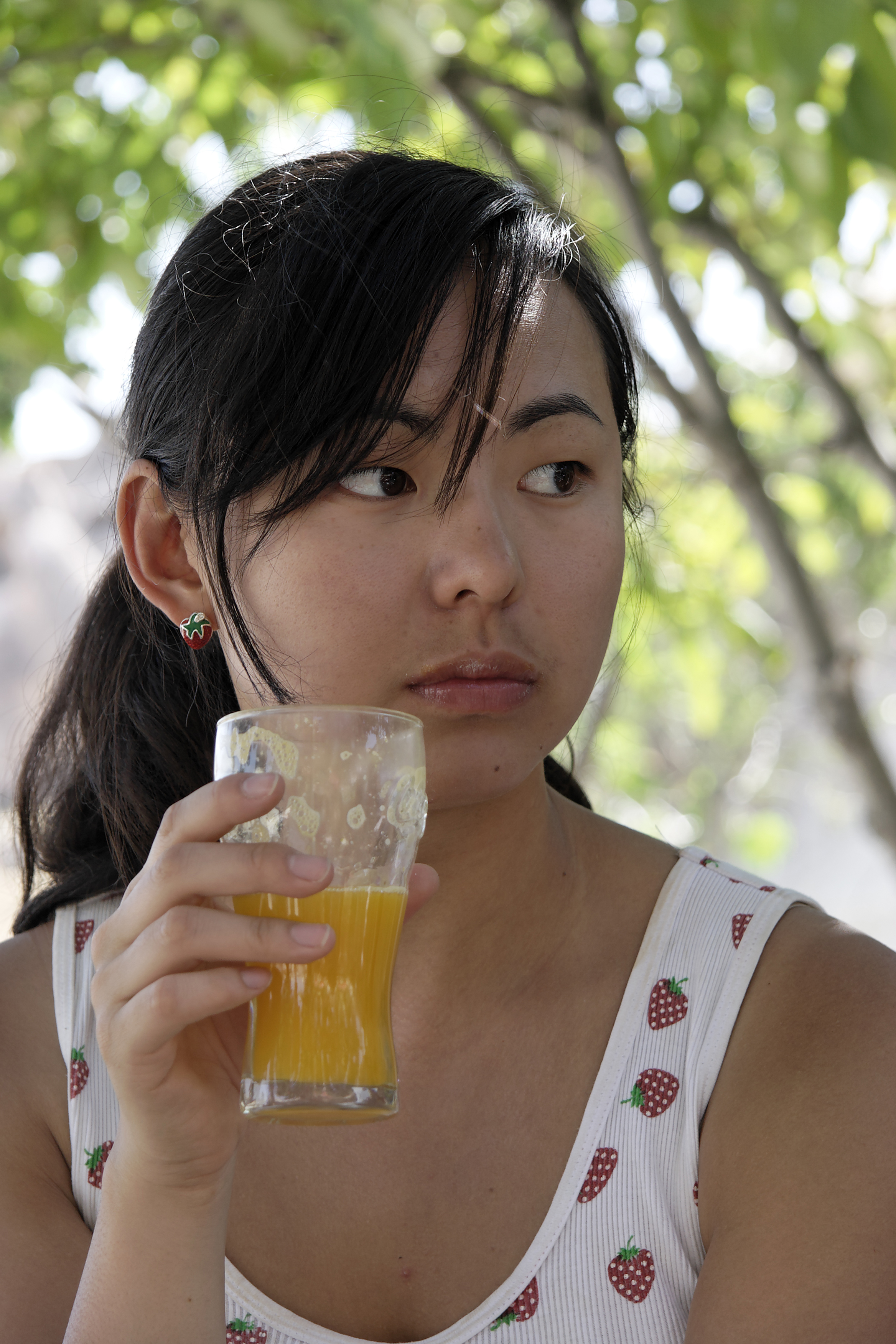 Girl with orange juice.jpg